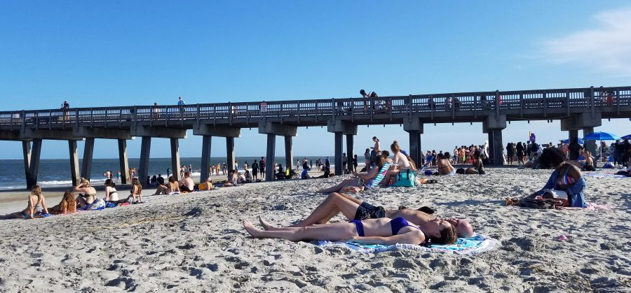 Students hanging out by the pier at last year's Beach Bash. Photo by Madison Watkins.
