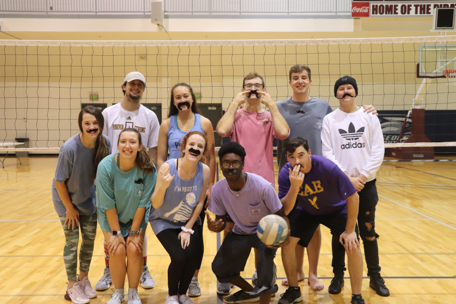 Justyn Ferguson, Trey Anderson, Spencer Demink, Tarah Yarred, Nolan Swain, Madison Hill, Kasey Lee, Dominic Chancey, Sam Floyd, Sarah Kistner, Allie Day,and Heather Pitman compete in the Movember Volleyball Tournament.