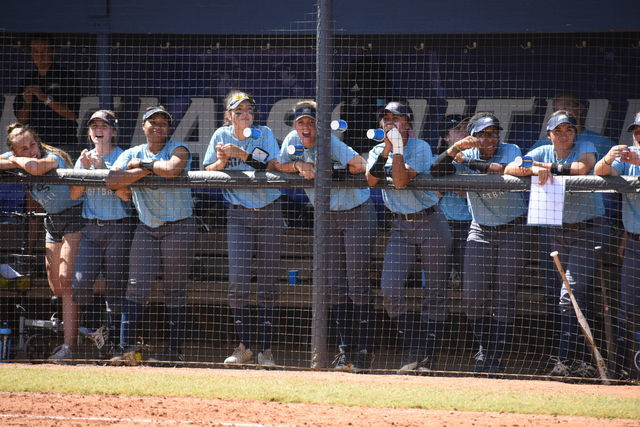 The Georgia Southern softball team leans over the gate watching the next Eagle at bat. The team will begin regular season with the Bash in the Boro tournament this weekend.