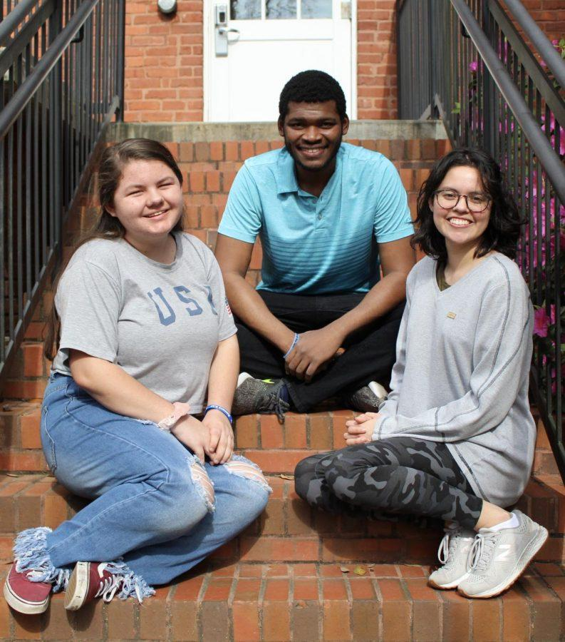 Chloe Johnsen, left, Fred Smith, middle, and Rachel Rubio, right, are all first generation college students. Photo by: Tamara Tanksley