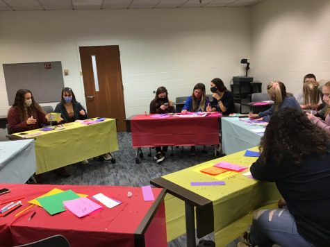 Phi Mu members decorating cards