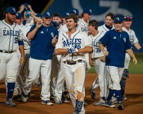 Austin Thompson (#22) celebrates a walk-off win against Mercer on April 14.
