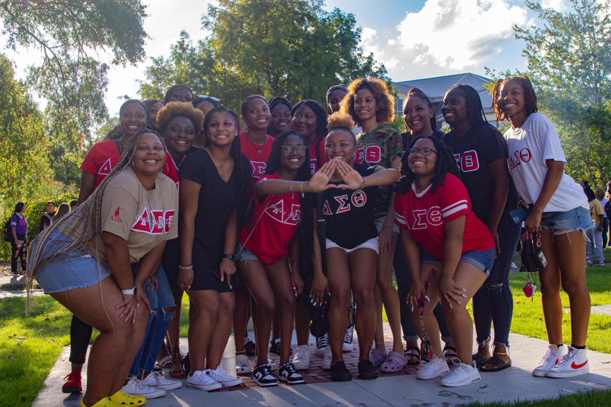 """Parrish poses with the current members of her sorority, Delta Sigma Theta. """"I didn't think they would include me… but I really felt proud to be included in that,"""" states Parrish."""