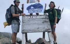 Wilson Calhoun (left), Dillon Calhoun and Christian Scott overlook the top of Mount Katahdin, their last stop on their 4-month long journey along the Appalachian trail. The hikers completed the trail July 15, 2021.