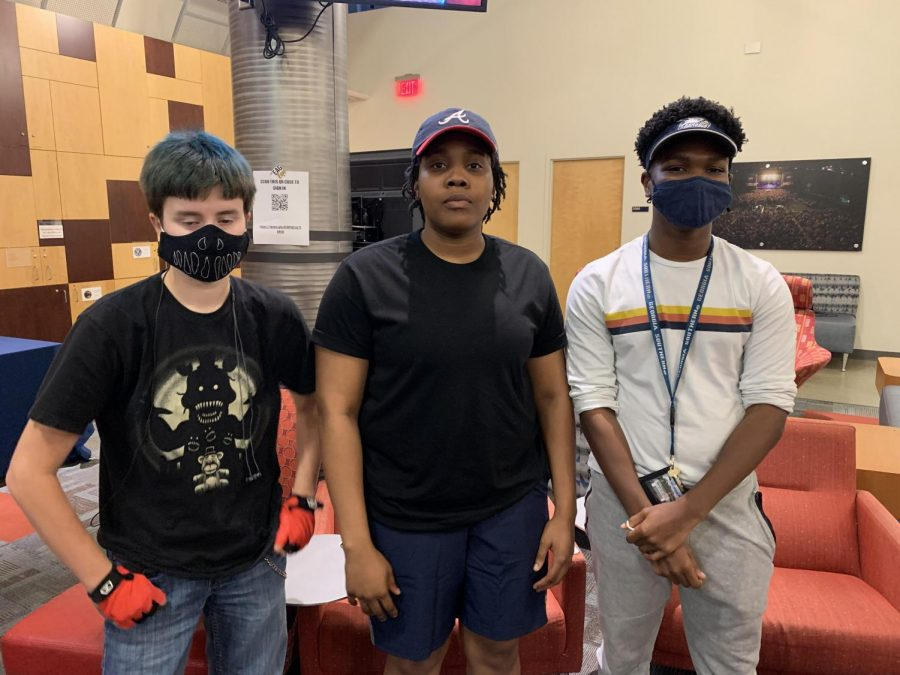 From left to right, Tyler Anderson (he/him), Akunna Chukwueke (she/her), and Gary Thomas (he/they).