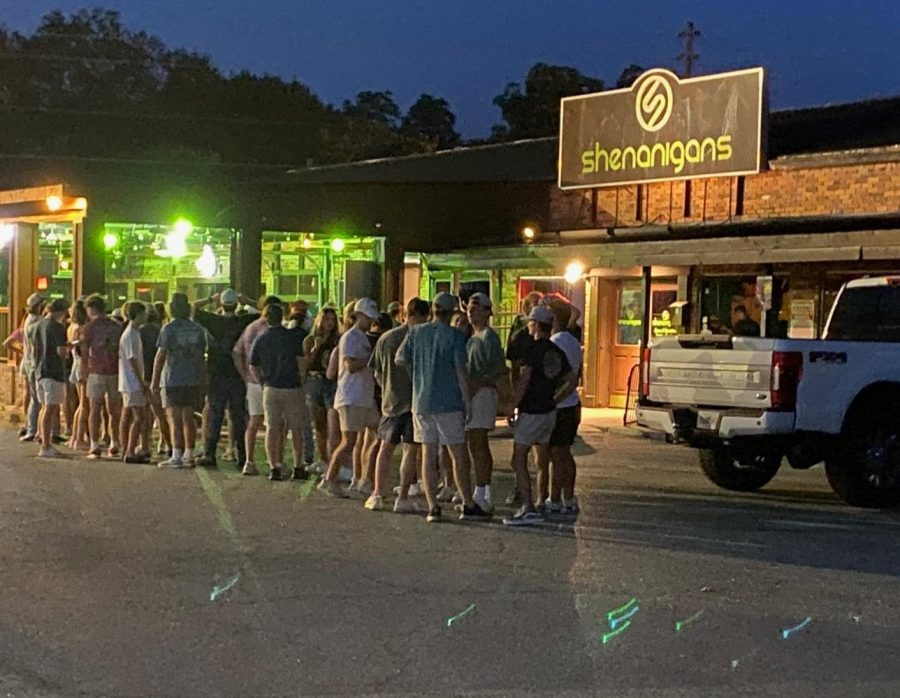 People wait to get inside Shenanigans bar for the first Wild Wednesday in two weeks on September 1, 2021. The bar recently closed following the arrests of a bartender, a bouncer and a night manager suspected of selling cocaine on August 20, 2021.