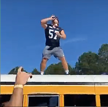 Screenshot from a video Barstool Southern posted to Instagram showing Gavin Adcock catching and downing a beer from the crowd on the way to play Lousiana on Saturday.